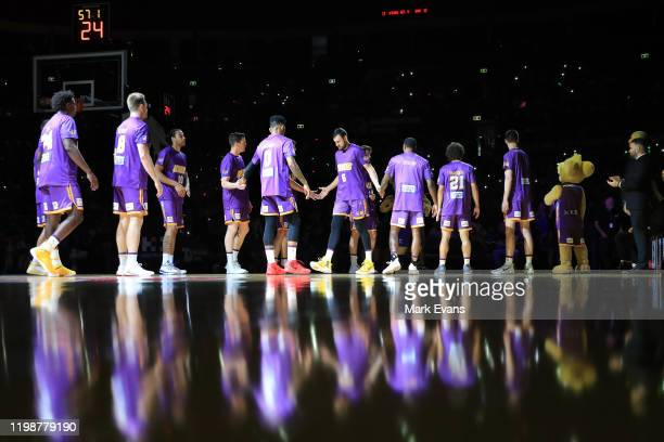 The Kings welcome Andrew Bogut on to the court during the round 15 NBL match between the Sydney Kings and the Cairns Taipans at Qudos Bank Arena on...