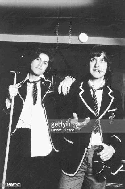 The Kinks Ray Davies and Dave Davies dressed in school uniform to promote the album 'Schoolboys In Disgrace' London January 1976
