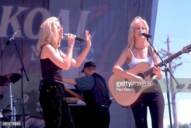 The Kinleys identical twin sisters Jennifer and Heather Kinley perform onstage Twin Lakes Wisconsin July 3 1998