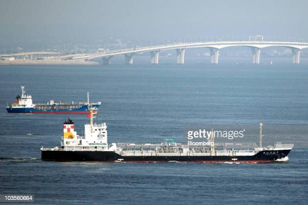 The Kintai Maru oil tanker right sails across Tokyo Bay as the Tokyo Bay AquaLine highway is seen in the background in Kawasaki City Kanagawa...