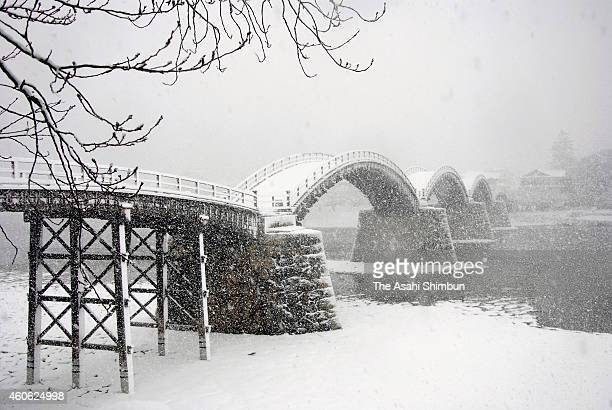 The Kintaikyo Bridge is covered with snow on December 17 2014 in Iwakuni Yamaguchi Japan A rapid development of the wintry low atmospheric pressure...