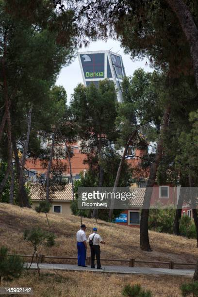 The Kio towers headquarters of Bankia SA are seen from a park in Madrid Spain on Friday June 8 2012 Spain is poised to become the fourth of the 17...
