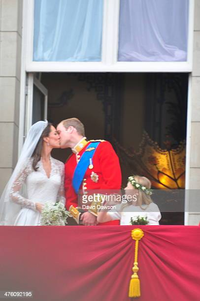 The kiss between the Duke and Duchess of Cambridge on the balcony of Buckingham Palace after the Royal wedding in London, England at Westminster...