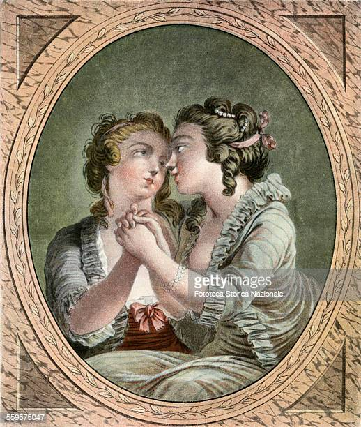 The kiss of friendship. Two friends give each other a delicate kiss. Licentious print by Doublet on a drawing by Janinet. France 1780. .
