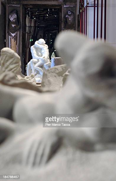 'The Kiss' the most famous marble statue by Auguste Rodin is displayed during the exhibition press preview in the Caryatid Room at Palazzo Reale on...