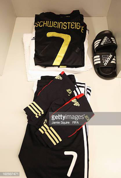 The kit of Bastian Schweinsteiger of Germany is seen in their dressing room before the 2010 FIFA World Cup South Africa Group D match between Ghana...