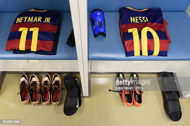 The kit of Neymar and Lionel Messi is laid out in the Barcelona dressing room ahead of the FIFA Club World Cup Japan 2015 Final between River Plate...