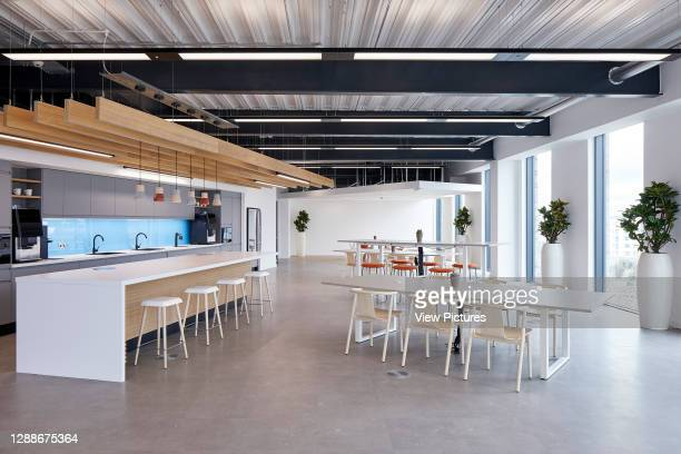 The kitchen area in a contemporary UK office interior with furniture. UK Office, London, United Kingdom. Architect: IOR, 2019.