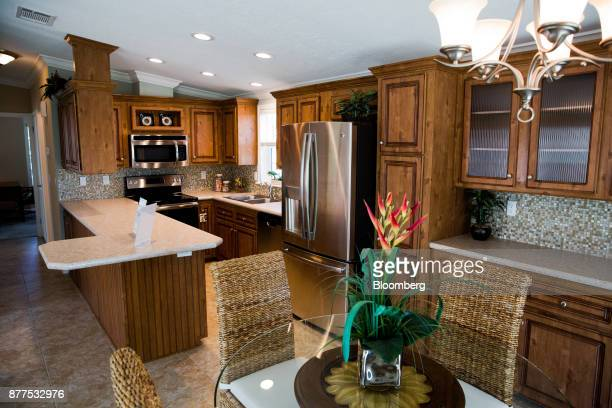 The kitchen of a model mobile home is seen at the LeeCorp Homes Inc dealership in Estero Florida US on Tuesday Oct 31 2017 Hurricane victims emerging...