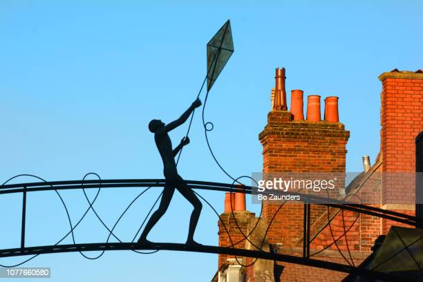 The Kite Flyer, a sculpture spanning Parchment Street in Winchester, England
