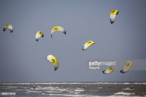 The Kite surfers competes during the 3rd Qidong YuanTuoJiao Kite Surfing Invitational Tournament on Day 1 at Qidong Golden Beach on October 6 2017 in...