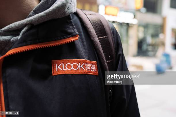 The Klook Travel Technology Ltd logo is displayed on a tour guide's jacket during a guided walking tour in Hong Kong China on Wednesday Feb 7 2018...