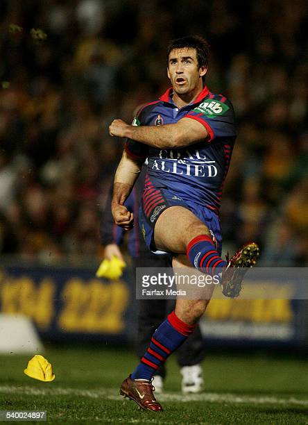 The Knights' Andrew Johns converts a try to break Jason Taylor's alltime point scoring record during the NRL Round 18 match between the Newcastle...