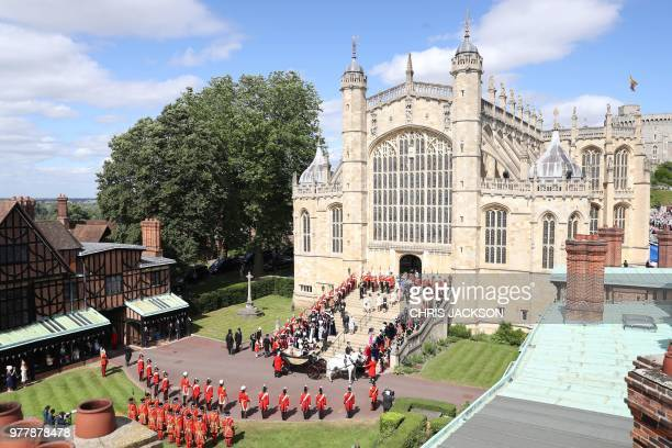 The Knights of the Garter guards military and members of the Royal family surround the west steps after the Most Noble Order of the Garter Ceremony...
