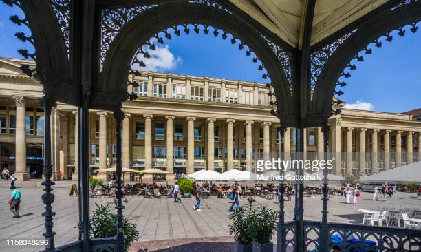 the königsbau prestigious retail building, a former concert hall and ballroom, seen from the schloßpark rotunda, stuttgart, baden-württemberg, germany, july 7, 2016 - castle square stock pictures, royalty-free photos & images