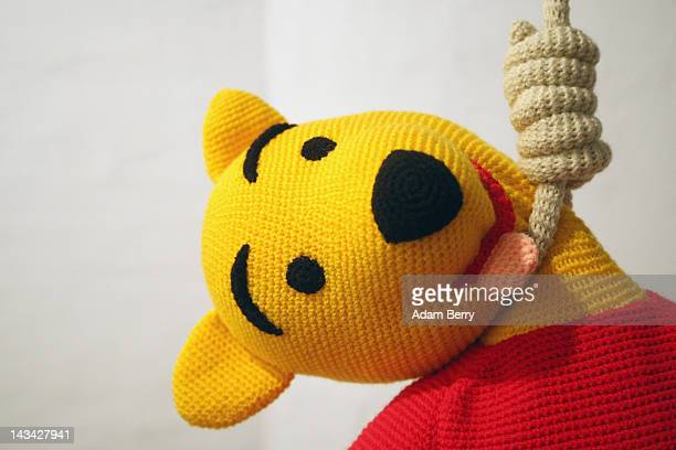 The knitted sculpture Winnie Pooh by Patricia Waller featuring the children's book character as a suicide victim hangs in the Broken Heroes...