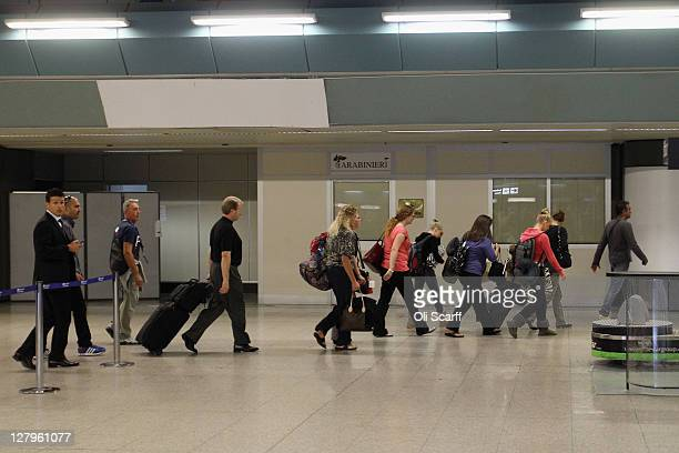 The Knox family including Amanda Knox's father Curt Knox prepare to depart from Rome's 'Fiumicino Leonardo da Vinci' airport for London on their...
