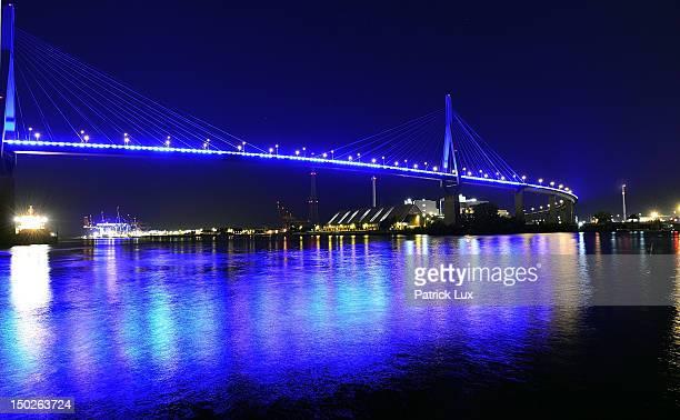 The Koehlbrandbruecke the main bridge in the harbour is illuminated in blue light during the Hamburg Blue Port light installation on August 13 2012...