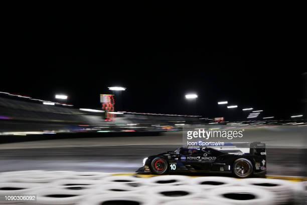 The Konica Minolta Cadillac DPiVR Cadillac DPi of Renger Van Der Zande Jordan Taylor Fernando Alonso and Kamui Kobayashi races through a turn during...