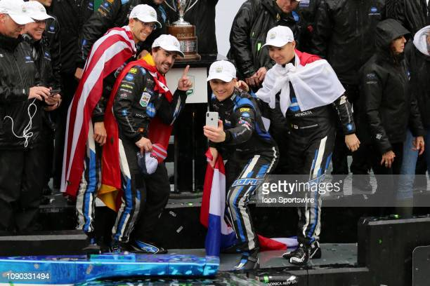 The Konica Minolta Cadillac DPiVR Cadillac DPi team of Renger Van Der Zande Jordan Taylor Fernando Alonso and Kamui Kobayashi celebrate after winning...