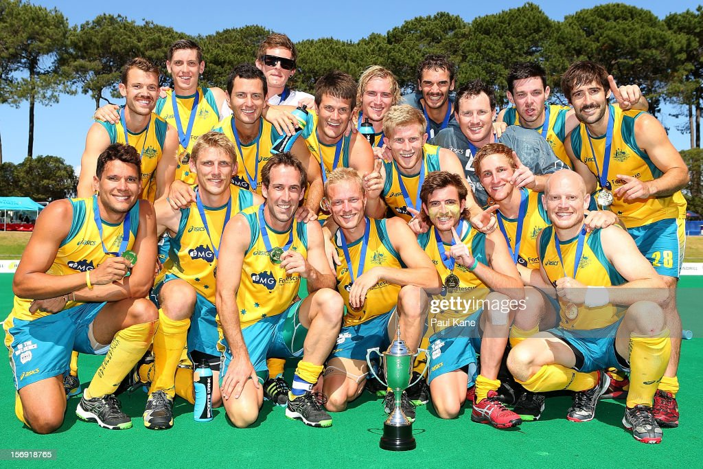The Kookaburras pose with the trophy after winning the gold medal match between the Australian Kookaburras and England during day four of the 2012 International Super Series at Perth Hockey Stadium on November 25, 2012 in Perth, Australia.