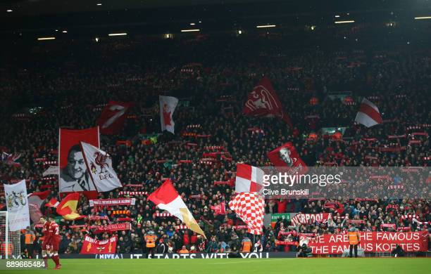 The Kop sing and wave banners prior to the Premier League match between Liverpool and Everton at Anfield on December 10 2017 in Liverpool England