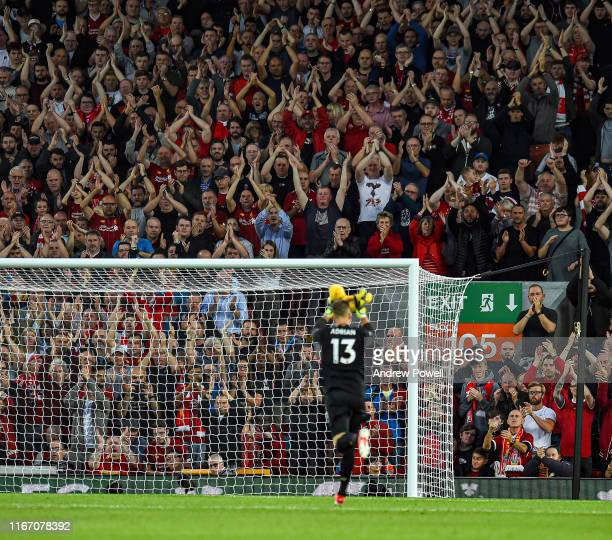 The Kop welcoming Adrian of Liverpool as he comes on during the Premier League match between Liverpool FC and Norwich City at Anfield on August 09,...