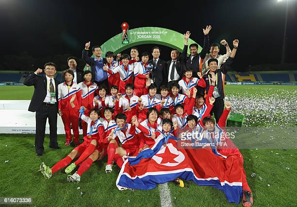 The Korea DPR celebrate with the FIFA U17 Women's World Cup Trophy after defeating Japan in the penalty shoot out during the FIFA U17 Women's World...