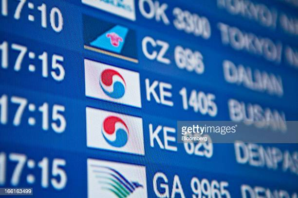 Korean air stock photos and pictures getty images the korean air lines co logo is displayed on a flight information screen at incheon international publicscrutiny Images