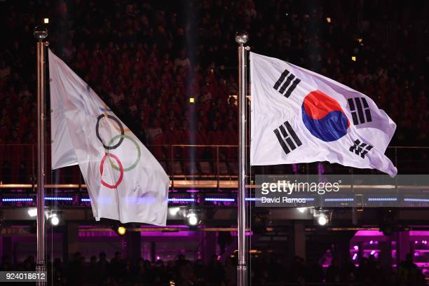 The Korean flag and Olympic flag fly during the Closing Ceremony of the PyeongChang 2018 Winter Olympic Games at PyeongChang Olympic Stadium on...