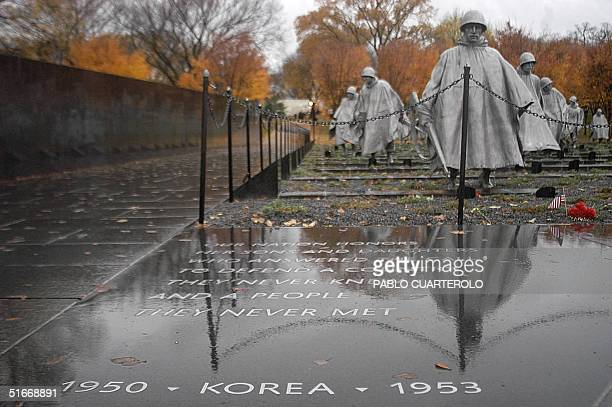 The Korean War Veterans Memorial is seen on a rainy day in Washington DC 12 November 2002 The memorial was built at a cost of 18 million USD in...