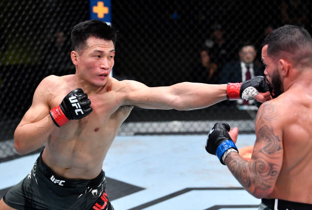 The Korean Zombie' Chan Sung Jung of South Korea punches Dan Ige in a featherweight bout during the UFC Fight Night event at UFC APEX on June 19,...