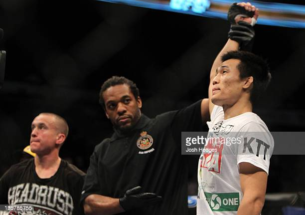 The Korean Zombie Chan Sung Jung reacts after knocking out Mark Hominick during the UFC 140 event at Air Canada Centre on December 10 2011 in Toronto...