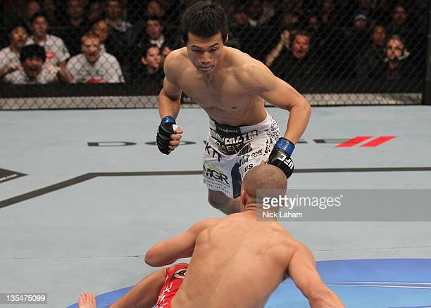 The Korean Zombie Chan Sung Jung rushes in to finish Mark Hominick after knocking him down with a punch during the UFC 140 event at Air Canada Centre...