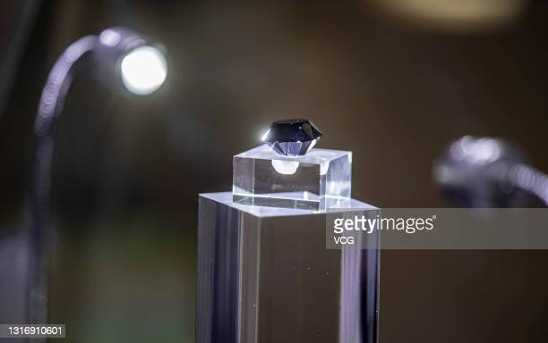 The Korloff Noir, a black diamond weighing 88 carats, is on display during the first China International Consumer Products Expo at Hainan...