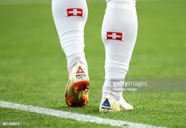 The Kosovo flag is seen on Xherdan Shaqiri of Switzerland's boots during the 2018 FIFA World Cup Russia group E match between Serbia and Switzerland...