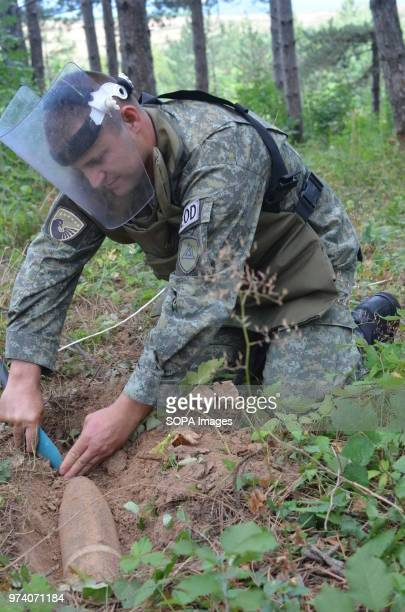 The Kosovo Security Force Emergency Ordinance Disposal team clear unexploded mines and shells in Freedom Park near Prizren southern Kosovo Kosovo was...