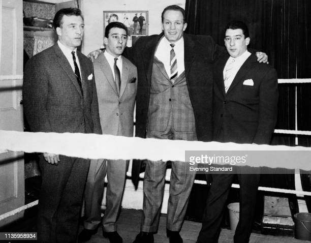 The Kray twins aka criminals and gangsters Ronald 'Ronnie' Kray and Reginald 'Reggie' Kray with British heavyweight boxer Henry Cooper London UK 6th...
