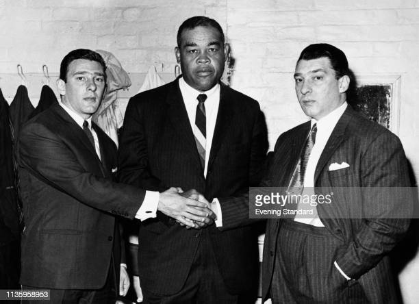 The Kray twins aka criminals and gangsters Ronald 'Ronnie' Kray and Reginald 'Reggie' Kray with American professional boxer Joe Louis London UK 6th...