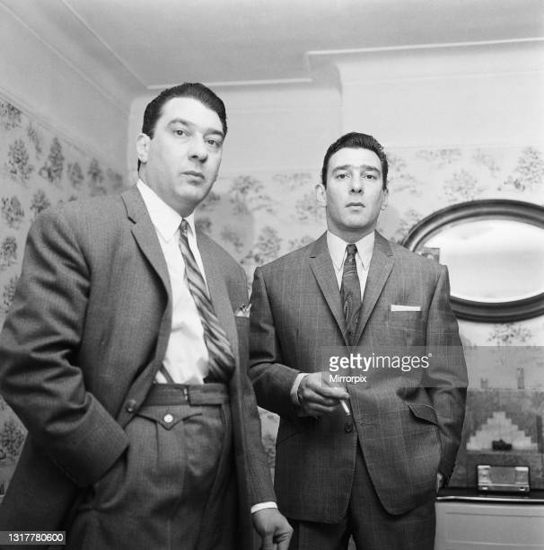The Kray Twins, Ronald and Reginald, seen here at home after helping police with their inquiries into a shooting at the Blind Beggar Pub, London, UK,...