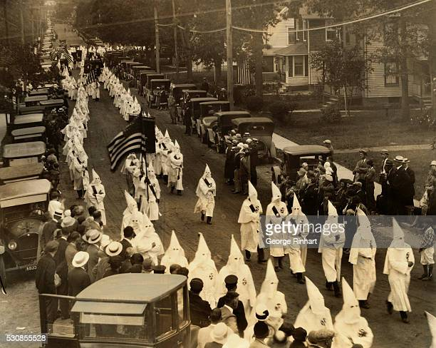 The Ku Klux Klan failed to make good its threat to parade through the streets of this town today and instead had a small parade in Neptune City and...