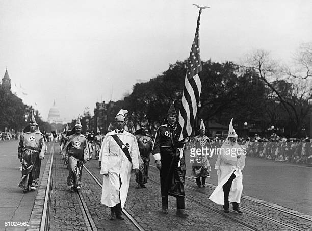 The Ku Klux Klan stage a parade in Washington DC, 1925. At the head of the procession is Klan member Shelby Cox. The police forbade the marchers to...