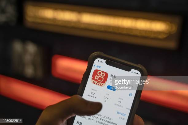 The Kuaishou Technology app download page on a smartphone arranged in Hong Kong, China, on Monday, Feb. 1, 2021. Institutional investors are buying...