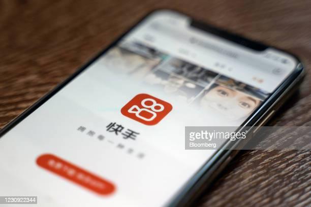 The Kuaishou Technology app logo on a smartphone arranged in Hong Kong, China, on Monday, Feb. 1, 2021. Institutional investors are buying Kuaishou's...