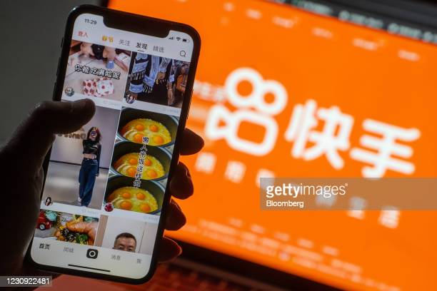 The Kuaishou Technology app on a smartphone arranged in Hong Kong, China, on Tuesday, Feb. 2, 2021. Institutional investors are buying Kuaishou's...