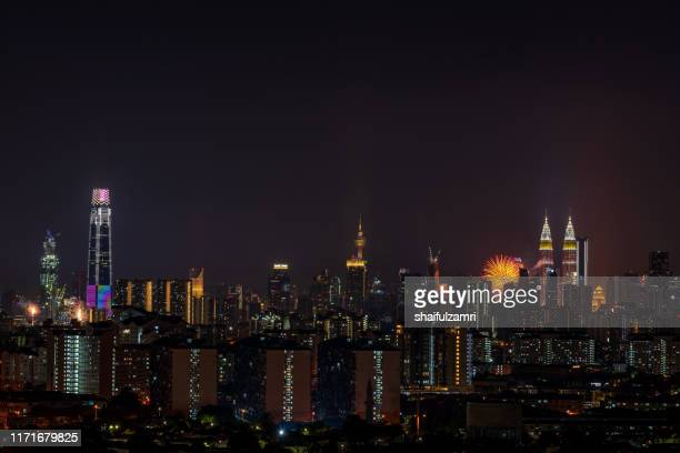 the kuala lumpur skyline glittered with a kaleidoscope of colours and spectacular lights and sound to mark the nation's 62 years of independence of malaysia. - shaifulzamri stock pictures, royalty-free photos & images