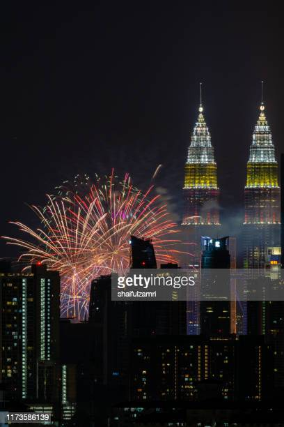 the kuala lumpur skyline glittered with a kaleidoscope of colours and spectacular lights and sound to mark the nation's 62 years of independence of malaysia. - shaifulzamri imagens e fotografias de stock