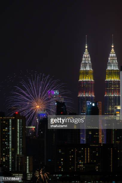 the kuala lumpur skyline glittered with a kaleidoscope of colours and spectacular lights from firework display. - shaifulzamri photos et images de collection