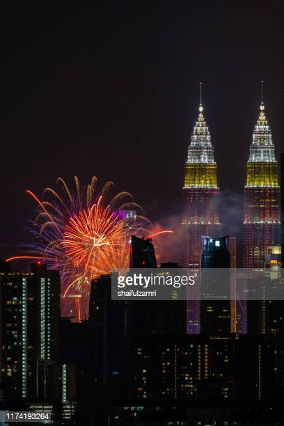 the kuala lumpur skyline glittered with a kaleidoscope of colours and spectacular lights from firework display. - shaifulzamri imagens e fotografias de stock
