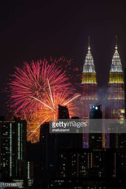 the kuala lumpur skyline glittered with a kaleidoscope of colours and spectacular lights from firework display. - shaifulzamri stock pictures, royalty-free photos & images